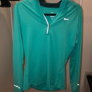 Nike quarter zip. Limited edition teal color